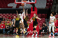COLLEGE PARK, MD - FEBRUARY 13: Kaila Charles #5 of Maryland shoots over Makenzie Meyer #3 of Iowa and Kathleen Doyle #22 of Iowa during a game between Iowa and Maryland at Xfinity Center on February 13, 2020 in College Park, Maryland.