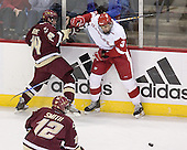 Matt Greene 14 of Boston College and Matt Olinger 3 of the University of Wisconsin battle along the boards. The Boston College Eagles defeated the University of Wisconsin Badgers 3-0 on Friday, October 27, 2006, at the Kohl Center in Madison, Wisconsin in their first meeting since the 2006 Frozen Four Final which Wisconsin won 2-1 to take the national championship.<br />