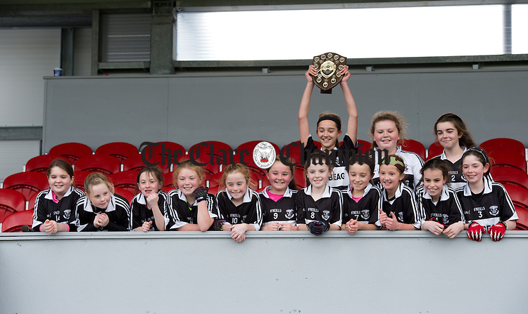 Bansha/Clohanes captain Keara Wealleans lifts the shield fro her team following their win over Stonehall NS in Division 3 at the Cumann na mBunscoil Finals in Cusack Park. Photograph by John Kelly.