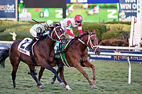 HALLANDALE BEACH, FL - JAN 13:Shining Copper #5  with Jose Ortiz on board wins the $200,000 Fort Lauderdale Stakes for trainer Michael J. Maker at Gulfstream Park on January 13, 2018 in Hallandale Beach, Florida. Second place went to One Go All Go #2 with Chris Landeros in the irons for trainer Charles L. Dickey. (Photo by Bob Aaron/Eclipse Sportswire/Getty Images)