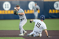 Eastern Michigan Eagles second baseman Drake Peggs (5) turns a double play during the NCAA baseball game as Michigan Wolverines baserunner Jimmy Kerr (15) slides into second on May 16, 2017 at Ray Fisher Stadium in Ann Arbor, Michigan. Michigan defeated Eastern Michigan 12-4. (Andrew Woolley/Four Seam Images)
