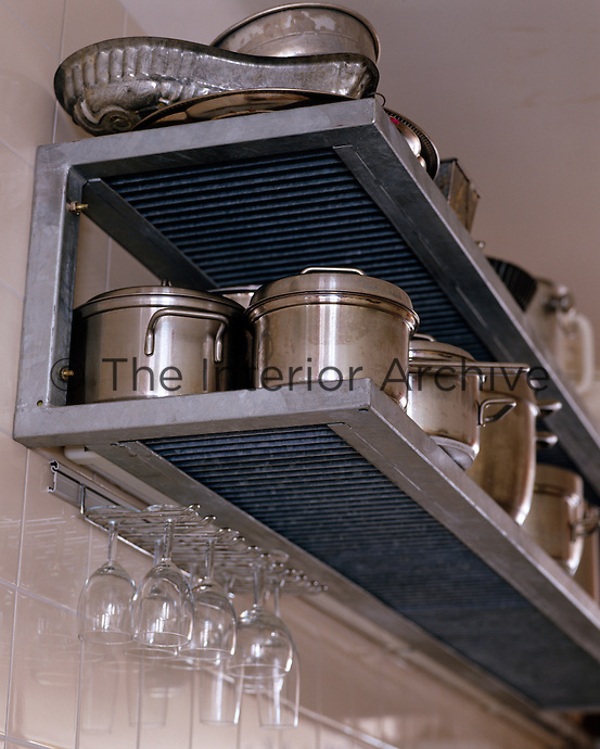 A well stacked industrial shelf is the sign of a good cook, with a pot for every necessity