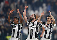 Calcio, Serie A: Juventus Stadium. Torino, Juventus Stadium, 29 ottobre 2016.<br /> From left, Juventus&rsquo; Alex Sandro, Gonzalo Higuain and Stephan Lichtsteiner celebrate at the end of the Italian Serie A football match between Juventus and Napoli at Turin's Juventus Stadium, 29 October 2016. Juventus won 2-1.<br /> UPDATE IMAGES PRESS/Isabella Bonotto