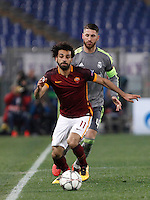 Calcio, andata degli ottavi di finale di Champions League: Roma vs Real Madrid. Roma, stadio Olimpico, 17 febbraio 2016.<br /> Roma's Mohamed Salah, left, is chased by Real Madrid's Sergio Ramos during the first leg round of 16 Champions League football match between Roma and Real Madrid, at Rome's Olympic stadium, 17 February 2016.<br /> UPDATE IMAGES PRESS/Isabella Bonotto