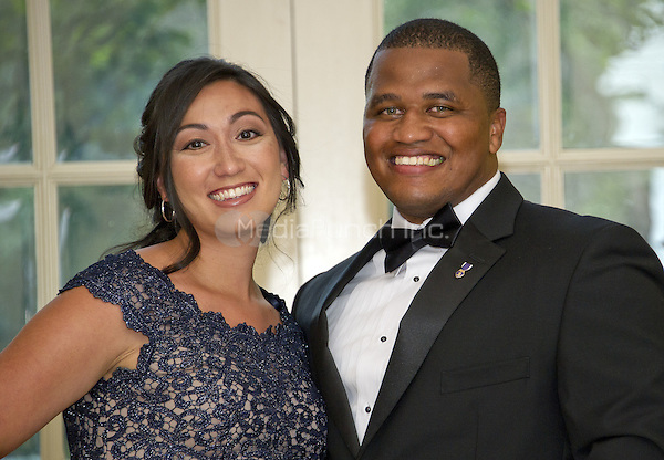 United States Army Major Jeremy Haynes and his wife US Army Reserves Sergeant First Class Chelsea Haynes arrive for the State Dinner honoring Prime Minister Lee Hsien Loong of the Republic of Singapore at the White House in Washington, DC on Tuesday, August 2, 2016. Major Haynes wrote to first lady Michelle Obama regarding the work of the Joining Forces initiative in July.<br /> Credit: Ron Sachs / Pool via CNP/MediaPunch