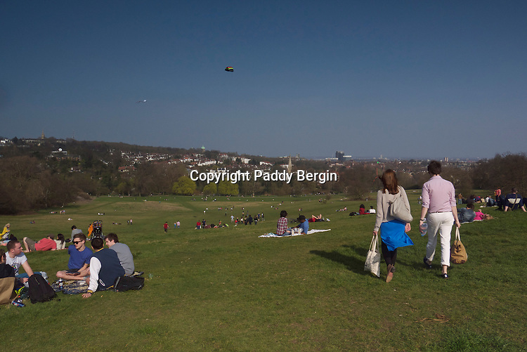 Kite Hill and picnickers on Hampstead Heath (locally known as &quot;the Heath&quot;) is a large, ancient London park, covering 320 hectares (790 acres). This grassy public space sits astride a sandy ridge, one of the highest points in London, running from Hampstead to Highgate, which rests on a band of London Clay. The Heath is rambling and hilly, embracing ponds, recent and ancient woodlands, a lido, playgrounds, and a training track, and it adjoins the stately home of Kenwood House and its grounds. The south-east part of the Heath is Parliament Hill, from which the view over London is protected by law.<br />