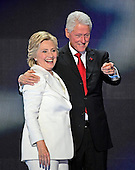 Former United States President Bill Clinton and Hillary Clinton, the Democratic Party nominee for President of the United States, on the podium as they anticipate the balloon drop following her acceptance speech during the fourth session of the 2016 Democratic National Convention at the Wells Fargo Center in Philadelphia, Pennsylvania on Thursday, July 28, 2016.<br /> Credit: Ron Sachs / CNP   <br /> (RESTRICTION: NO New York or New Jersey Newspapers or newspapers within a 75 mile radius of New York City)