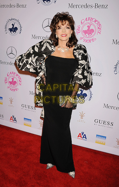 Joan Collins.The 26th Anniversary Carousel Of Hope Ball presented by Mercedes-Benz at The Beverly Hilton Hotel in Beverly Hills, California, USA..October 20th, 2012.full length hand on hip dress black white print jacket gloves .CAP/ROT/TM.©Tony Michaels/Roth Stock/Capital Pictures