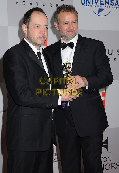 Gareth Neame and Hugh Bonneville.NBC Universal Golden Globes After Party held at the Beverly Hilton Hotel, Hollywood, California, USA..January 15th, 2012.half length black suit tuxedo award trophy winner .CAP/ADM/BT.©Birdie Thompson/AdMedia/Capital Pictures.