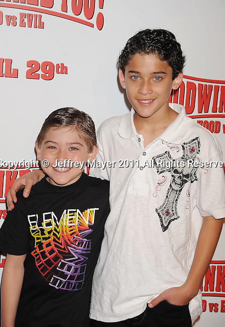 "LOS ANGELES, CA - APRIL 16: Raymond Ochoa and Robert Ochoa arrive at ""Hoodwinked Too! Hood Vs Evil"" Los Angeles premiere at Pacific Theatres at The Grove on April 16, 2011 in Los Angeles, California."