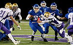 SIOUX FALLS, SD - OCTOBER 25: Parker Nelson #20 from Sioux Falls Christian looks to slip past Preston Norrid #20 from Winner in the first half of their 11B playoff game Thursday nigh at Bob Young Field in Sioux Falls.(Photo by Dave Eggen/Inertia)