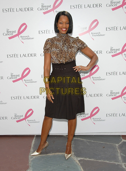 "GARCELLE BEAUVAIS-NILON.The Estee Lauder Garden Luncheon in Honor of Gwyneth Paltrow and the ""pleasures by Gwyneth Paltrow"" Limited Edition Launch held at The Greystone Estate in Beverly HIlls, California, USA..September 20th, 2006.Ref: DVS.full length black skirt leopard print top hand on hip.www.capitalpictures.com.sales@capitalpictures.com.©Debbie VanStory/Capital Pictures"
