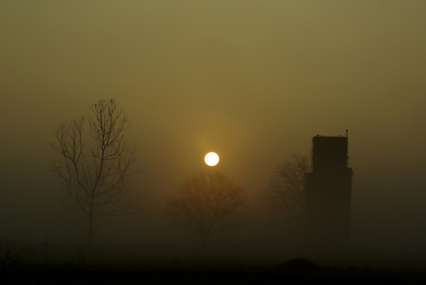 Sunrise with old silo near Galloway, Arkansas