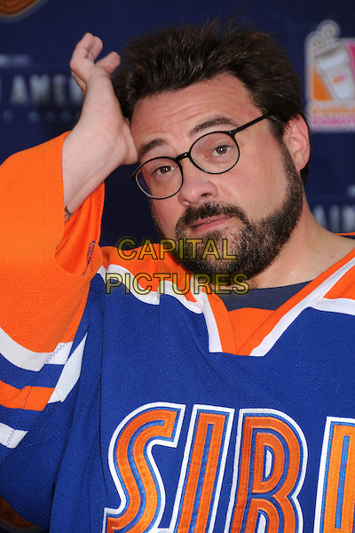 "Kevin Smith.""Captain America: The First Avenger"" Los Angeles Premiere held at the El Capitan Theatre, Hollywood, California, USA..July 19th, 2011.headshot portrait orange blue glasses beard facial hair hand .CAP/ADM/BP.©Byron Purvis/AdMedia/Capital Pictures."