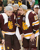 "Mike Connolly (Duluth - 22), Justin Fontaine (Duluth - 37), Dale ""Hoagie"" Haagenson (Duluth - Manager), Justin Faulk (Duluth - 25), Derek Plante (Duluth - Assistant Coach) - The University of Minnesota-Duluth Bulldogs celebrated their 2011 D1 National Championship win on Saturday, April 9, 2011, at the Xcel Energy Center in St. Paul, Minnesota."