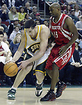 Seattle SuperSonics'  Nick Collison (L) grabs a loose ball in front of Houston Rockets'  Mike James during the second period of their game at Key Arena in Seattle, Washington Monday, 11 April 2005.  Jim Bryant Photo. ©2010. All Rights Reserved.