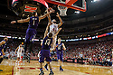 March 1, 2014: Terran Petteway (44) of the Nebraska Cornhuskers with a lay up against Drew Crawford (1) of the Northwestern Wildcats and Tre Demps (14) of the Northwestern Wildcats during the second half at the Pinnacle Bank Arena, Lincoln, NE. Nebraska 54 Northwestern 47.