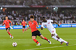 Almoez Ali of Qatar (R) fights for the ball with Kim Minjae of South Korea (L) during the AFC Asian Cup UAE 2019 Quarter Finals match between Qatar (QAT) and South Korea (KOR) at Zayed Sports City Stadium  on 25 January 2019 in Abu Dhabi, United Arab Emirates. Photo by Marcio Rodrigo Machado / Power Sport Images