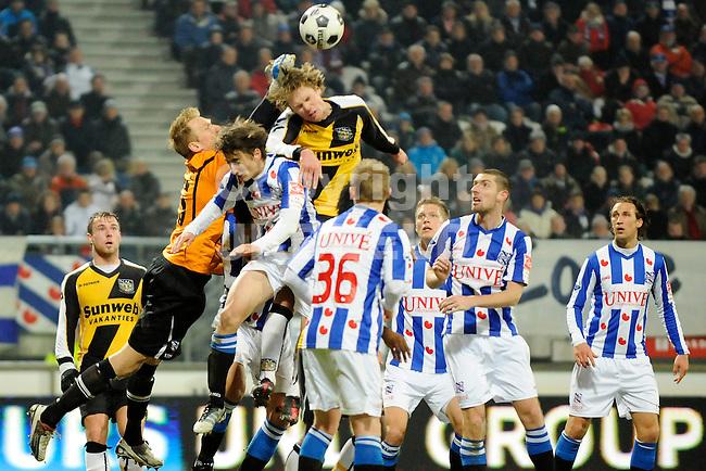 HEERENVEEN - Voetbal, SC Heerenveen - NAC , Eredivisie,  Abe Lenstra stadion, seizoen 2011-2012, 17-02-2012 SC Heerenveen doelman Brian Vandenbussche stompt de bal eweg boven het hoofd van NAC Breda speler Kees Luijckx.