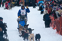 John Baker team leaves the start line during the restart day of Iditarod 2009 in Willow, Alaska