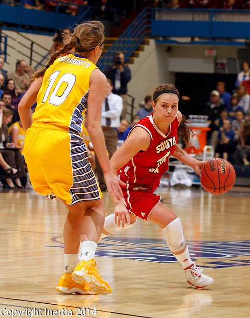 SIOUX FALLS, SD - MARCH 10:  Tia Hemiller #4 from University of South Dakota drives against Kerry Young #10 from South Dakota State University in the second half of their semifinal game Monday afternoon at the 2014 Summit League Basketball Tournament in Sioux Falls, SD. (Photo by Dave Eggen/Inertia)