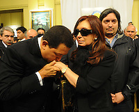 President of Venezuela Hugo chavez kisses the hand of Argentina President Cristina Fernandez during the funeral of her husband Nestor Kirchner at Presidential Palace in Buenos Aires,  Thursday, October 28, 2010.