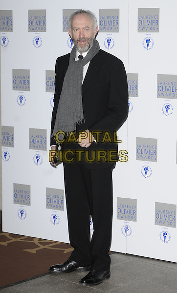 JONATHAN PRYCE.The Laurence Olivier Awards 2010, Grosvenor House Hotel, London, England. .21st March 2010.full length black suit grey gray scarf beard facial hair .CAP/CAN.©Can Nguyen/Capital Pictures.