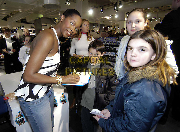 JAMELIA.performs live in HMV Oxford Street to promote the re-release of her album Thank You.01 March 2004.music, gig, concert, signing autographs, fans, half length, half-length, black and white geometric print top.www.capitalpictures.com.sales@capitalpictures.com.©Capital Pictures