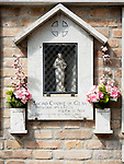 Shrine with pink flowers, Sacro Cuore di Gesu, Venice, Italy.