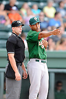 Manager Luis Rojas (19) of the Savannah Sand Gnats argues a call with home plate umpire George Reidel during a game against the Greenville Drive on Friday, August 22, 2014, at Fluor Field at the West End in Greenville, South Carolina. Greenville won, 6-5. (Tom Priddy/Four Seam Images)