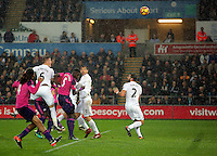 Alfie Mawson of Swansea City heads the ball over the bar during the Premier League match between Swansea City and Sunderland at The Liberty Stadium, Swansea, Wales, UK. Saturday 10 December 2016