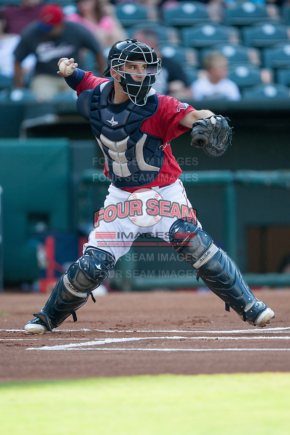Oklahoma City RedHawks catcher Ryan McCurdy (3) throws to 2nd base at the Chickasaw Bricktown Ballpark during the Pacific League game against the Colorado Springs Sky Sox on August 3, 2014 in Oklahoma City, Oklahoma.  The RedHawks defeated the Sky Sox 8-1.  (William Purnell/Four Seam Images)