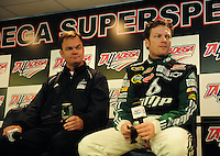 Oct. 30, 2009; Talladega, AL, USA; NASCAR Sprint Cup Series driver Dale Earnhardt Jr (right) at a press conference announcing Lance McGrew as his crew chief for the 2010 season prior to practice for the Amp Energy 500 at the Talladega Superspeedway. Mandatory Credit: Mark J. Rebilas-