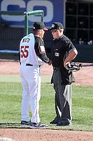 Rochester Red Wings manager Tom Nieto #55 argues a call with umpire Toby Basner during a game against the Scranton Wilkes-Barre Yankees at Frontier Field on April 9, 2011 in Rochester, New York.  Rochester defeated Scranton 7-6 in twelve innings.  Photo By Mike Janes/Four Seam Images