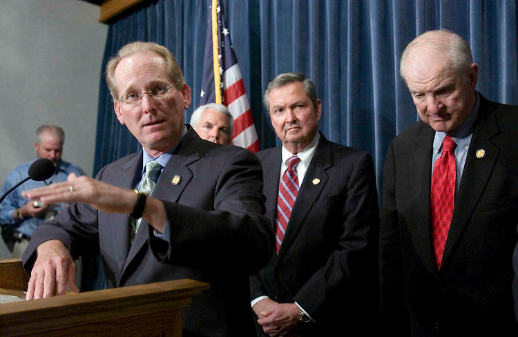 06/22/05.GROW ACCOUNTS/SOCIAL SECURITY--House Ways and Means Social Security Subcommittee Chairman Jim McCrery, R-La., with fellow Ways and Means members E. Clay Shaw Jr., R-Fla., and Sam Johnson, R-Texas, during a news conference announcing a proposal instituting GROW (Growing Real Ownership for Workers) accounts aimed at protecting the Social Security surplus by creating personal accounts. (Republican Policy Committee Chairman John Shadegg, R-Ariz., is obscured.) The proposal is supported by Ways and Means Chairman Bill Thomas, R-Calif.  .CONGRESSIONAL QUARTERLY PHOTO BY SCOTT J. FERRELL