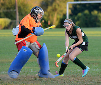 MORRISVILLE, PA -  OCTOBER 2: Morrisville's goalie SIdney Knott makes a save after a shot by George School's Winter Pisco during a girls field hockey game October 2, 2013 in Morrisville, Pennsylvania.  (Photo by William Thomas Cain/Cain Images)