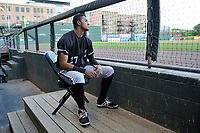 Center fielder Joel Booker (27) of the Kannapolis Intimidators in the dugout before Game 4 of the South Atlantic League Championship Series against the Greenville Drive on Friday, September 15, 2017, at Fluor Field at the West End in Greenville, South Carolina. Greenville won 8-3 for the team's first SAL Championship, winning the series 3-1. (Tom Priddy/Four Seam Images)