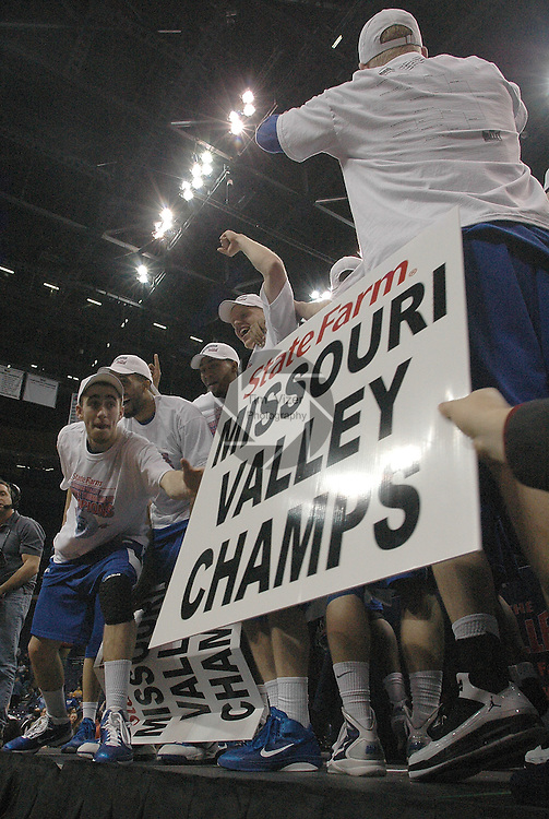 March 5,  2011         Indiana State Sycamores guard Jake Odum (left) reaches out to take a sign from a fan after Indiana State defeated MIssouri State 60-56 in the championship game of the NCAA Missouri Valley Conference Men's Basketball Tournament on Sunday March 6, 2011 at the Scottrade Center in downtown St. Louis.  They received an automatic bid to the NCAA Basketball Tournament