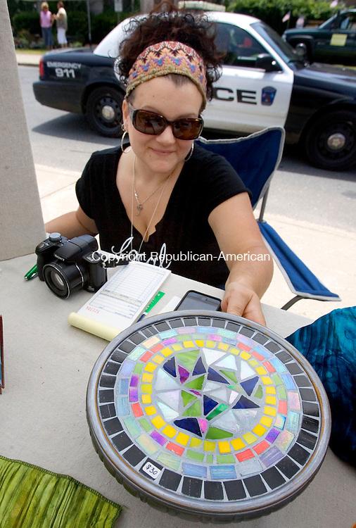 THOMASTON CT. 22 June 2013-062213SV10-Jeanie Molnar of Thomaston sells her mosaic artwork during the annual ArtzFest downtown Thomaston Saturday.<br /> Steven Valenti Republican-American
