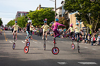 Girl on Giraffe Unicycles, 17th of May Festival 2016, Norway's Constitution Day, Ballard, Seattle, WA, USA.