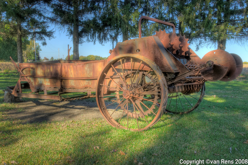 International Harvester Manure spreader from around 1920's. Discarded farm machinery has become fashionable decorative yard ornament and conversation starter as well as a window into the past practices.