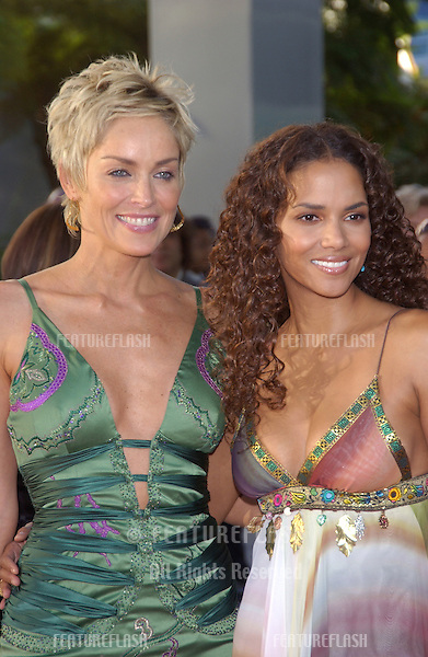 Actresses HALLE BERRY (right) & SHARON STONE at the world premiere, in Hollywood, of their new movie Catwoman..July 19, 2004