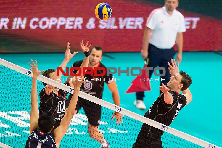 07.09.2014, Spodek, Kattowitz<br /> Volleyball, FIVB Volleyball Men`s World Championship 2014, Deutschland (GER) vs. Korea (KOR)<br /> <br /> Block Yung-Suk Shin (#4 KOR) - Zuspiel Lukas Kampa (#11 GER), Marcus B&ouml;hme / Boehme (#8 GER)<br /> <br />   Foto &copy; nordphoto / Kurth