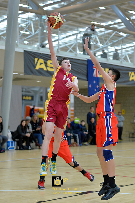 Action from the Basketball - U15 National Champs at ASB Sports Centre, Wellington, New Zealand on Friday 18 July 2014. <br /> Photo by Masanori Udagawa. <br /> www.photowellington.photoshelter.com.