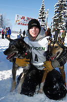 2009 Junior Iditarod Champion Cain Carter poses with his lead dogs Dred (L) and Rev ( R ) at the finish line of the 2009 Junior Iditarod in Willow, Alaska.   Cain is the step-son of current Iditarod champion Lance Mackey and ran Lance's Iditarod team.  March 1, 2009