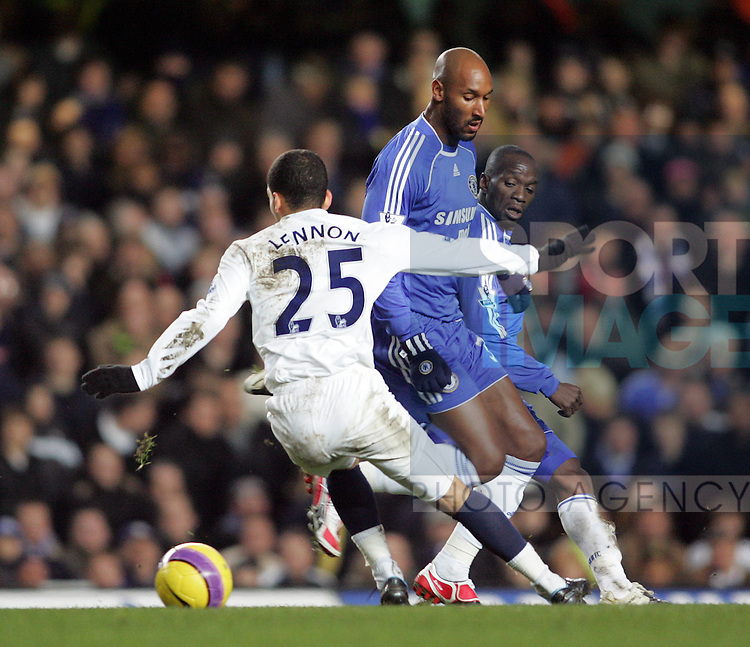 Chelsea's Nicolas Anelka tussles with Tottenham's Aaron Lennon