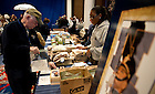 Nov. 20, 2010; Alumni and visitors fill care packages to send to U.S. Military members as part of the Alumni Association Service project at the Official University Tailgate before the Notre Dame-Army game at Yankee Stadium...Photo by Matt Cashore/University of Notre Dame