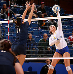 BROOKINGS, SD - NOVEMBER 14:  Ashley Beaner #1 from South Dakota State University looks to get a kill past Sara Pope #11 from Oral Roberts University during their volleyball match Friday night at Frost Arena. (Photo by Dave Eggen/Inertia)
