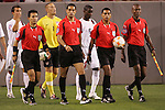 11 March 2008: Game officials lead the players onto the pitch, pregame.  Left to right: Assistant Referee Marvin Torrentera (MEX), Fourth Official Roberto Garcia (MEX), Referee Walter Lopez (GUA), Assistant Referee Dion Inniss (GUY). The United States U-23 Men's National Team tied the Cuba U-23 Men's National Team 1-1 at Raymond James Stadium in Tampa, FL in a Group A game during the 2008 CONCACAF's Men's Olympic Qualifying Tournament.