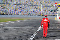 Feb 08, 2009; Daytona Beach, FL, USA; NASCAR Sprint Cup Series driver Tony Stewart walks towards the garage following qualifying for the Daytona 500 at Daytona International Speedway. Mandatory Credit: Mark J. Rebilas-